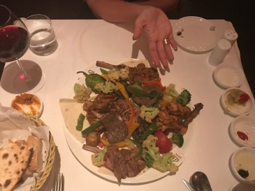 Feasting on large quantities of meat at Garlic